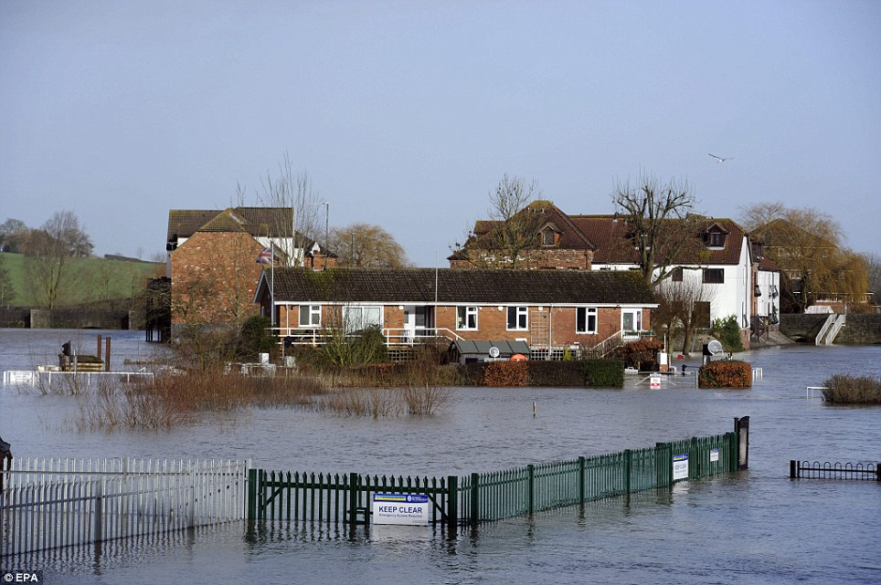 Residential homes surrounded by flood waters in Tewkesbury, Gloucestershire UK