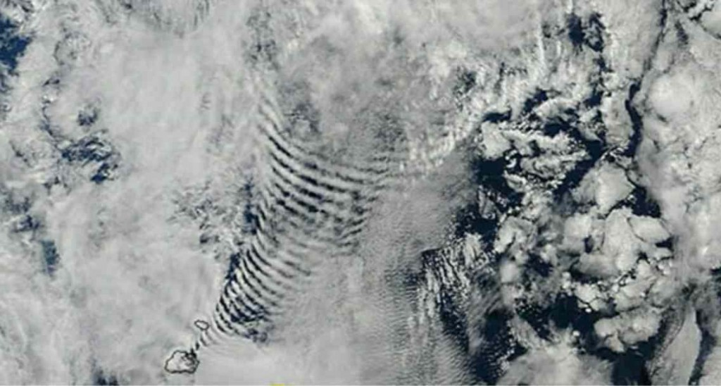 Funnel-like periodic cloud pattern radiates from a high tech base on Marion Island.