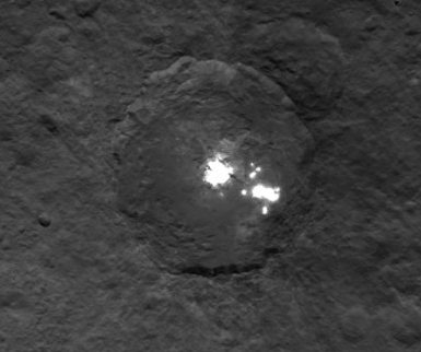 Hi res view of Ceres bright  spots taken at an altitude of 4500 km.  Released June 6th