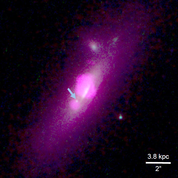 Composite image from the NASA/ESA Hubble Space Telescope and NASA's Chandra X-ray Observatory shows the galaxy SDSS J112659.54+294442.8. The arrow points to the galactic core fragment that fisioned from the galaxy's central core. Image credit: NASA / ESA / Hubble Team / Chandra Team / Julia M. Comerford et al.