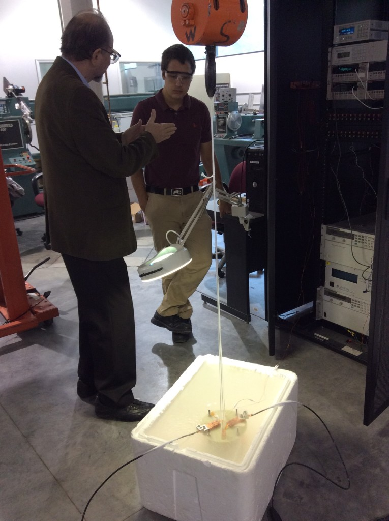 Dr. Nassikas discussing the test setup with one of the Superpower techs.